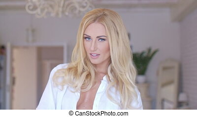 Seductive Woman in White Shirt Looking at Camera - Close up...