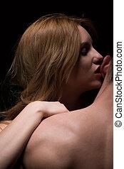 Seductive woman kissing man