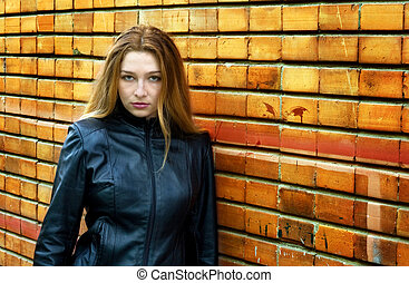Seductive woman standing against wall