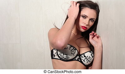 Seductive woman with red lips and red nails isolated on