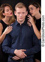 Seductive women tempting handsome man - Love triangle - ...