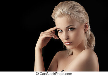 seductive young blonde woman on black