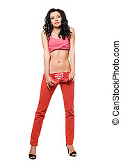 Seductive young brunette in a red jeans