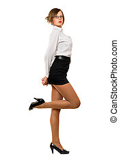 Seductive young woman in a black skirt and white shirt