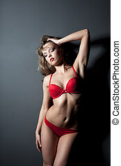 Seductive young woman in red underwear, close-up