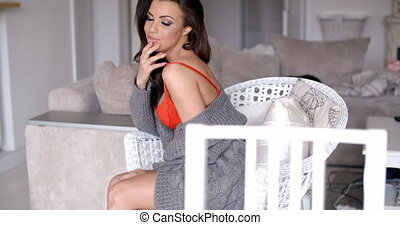 Seductive Young Woman Relaxing on White Chair
