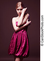 Seductive young woman wearing on pink dress