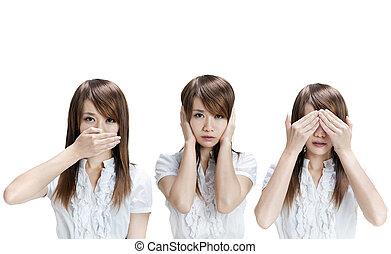 See, hear, speak no evil - Woman showing different gesture...