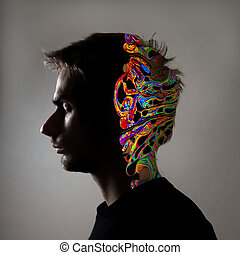 Side profile of a human face and see through illustration of the brain.