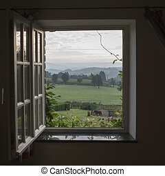 see through window with garden horses and hills