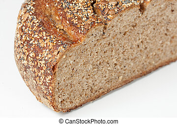 Close up of half a loaf of seeded multi-grain bread.
