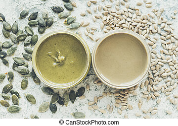Seeds butter in glass jars