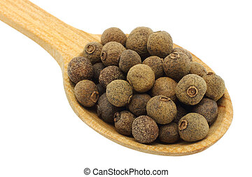 Seeds of allspice in wooden spoon on white background