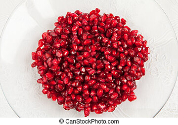 Seeds of pomegranate on a plate