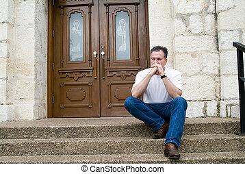 Seeking Confession - Man sitting on the steps of a church...