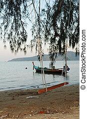 Seesaw on tropic beach