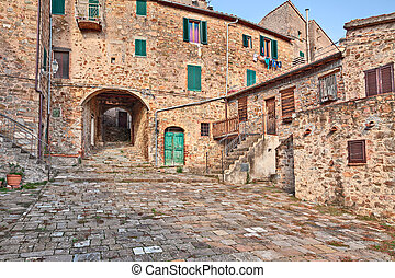 Seggiano, Grosseto, Tuscany, Italy: ancient square, alley and underpass in the old town of the medieval village on the tuscan mountain