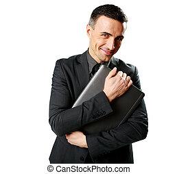 segurando, laptop, isolado, fundo, homem negócios, branca, feliz