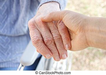 segurando, senior's, mão