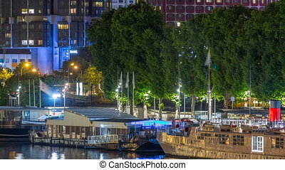 Seine river with ship in Paris at night timelapse,...