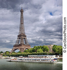 The passenger ship on river Seine near to Eiffel tower in Paris, France.