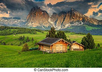 Seiser Alm resort and Langkofel group at sunset, Dolomites,...