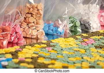 Seized color pills of extasy (MDMA, E, X) collected by drug...