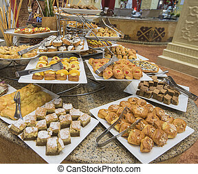 Selction of sweet pastries at a restaurant buffet