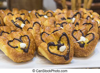 Selction of sweet pastries at a restaurant buffet -...