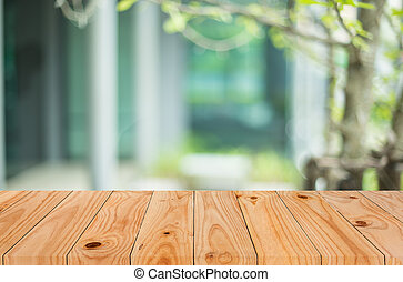 Selected focus empty brown wooden table and Coffee shop blur background with bokeh image, for product display montage