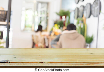 Selected focus empty brown wooden table and Coffee shop blur background with bokeh image
