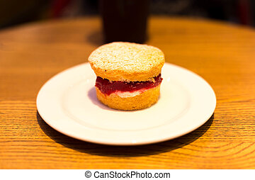 Selected focus on strawberry jam English scone