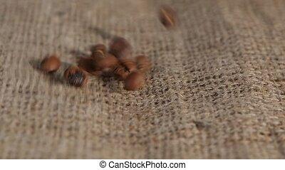 Selected grain fragrant coffee brown burlap fall on lying....