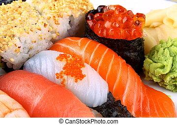 Selected sushi delicacy with ikura and wasabi, closeup