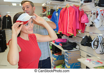selecting a golf cap