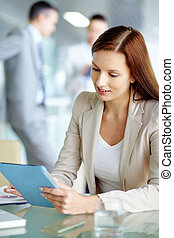Selecting data - Portrait of confident employee working with...