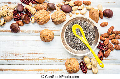 Selection food sources of omega 3 and unsaturated fats. Superfood high vitamin e and dietary fiber for healthy food. Mixed nuts almond ,pecan, hazelnuts, walnuts and various beans on white background.