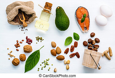 Selection food sources of omega 3 . Superfood high unsaturated fats for healthy food. Nutshell and lentils flat lay on white wooden table.