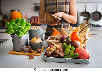 Selection of Autumn fruits and vegetables on kitchen counter...