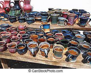 Selection of beautiful colorful handmade ceramics pottery mugs