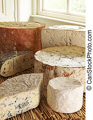 Selection Of Blue Cheeses On Display In Delicatessen