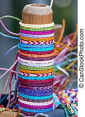 Selection of color thread bracelets