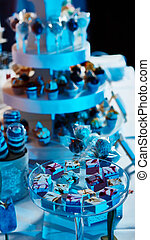 Selection of decorative desserts on buffet table at catered event