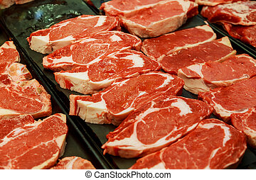Selection of different cuts of fresh raw red meat in supermarket