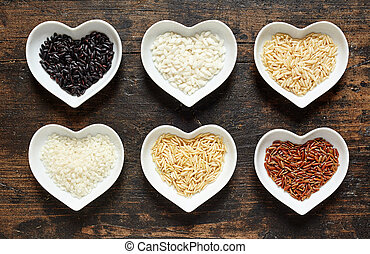 Selection of different rice in heart shaped dishes
