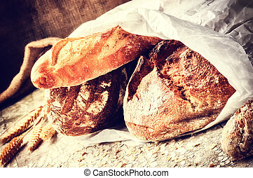 Selection of freshly baked bread in paper bag