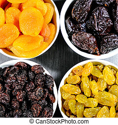 Selection of Healthy Dried Fruits In White Bowls