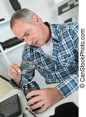 selection of lenses on photographer desk vintage effect