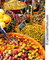 selection of olives on a market
