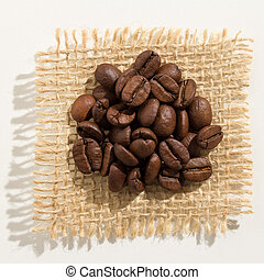 coffee beans seed. Close up of grains over burlap.